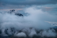 Ristind mountain peak emerges from clouds, Vestvågøy, Lofoten Islands, Norway