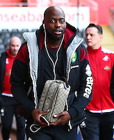 Yossuf Mulumbu of Norwich City wearing Apple earphones during the Barclays Premier League match between Swansea City and Norwich City played at The Liberty Stadium, Swansea on March 5th 2016