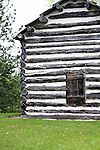 historical log cabin window building logcabin structure old past long ago 150 years historic deterioration aging fashioned glass wood recycle build by hand home house farm settlement settle memories united states west time plaster construction material stripes door security locked lock secure safe protected preservation preserve logs shutters 1849 Sparrow Cabin