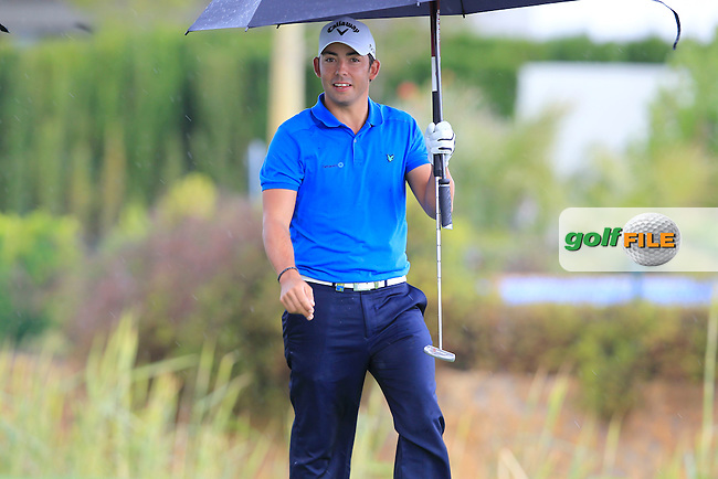Pablo Larrazabal (ESP) takes shelter from the rain after teeing off on the par3 17th hole during Thursday's Round 1 of the Open de Espana at Real Club de Golf de Sevilla, Seville, Spain, 3rd May 2012 (Photo Eoin Clarke/www.golffile.ie)