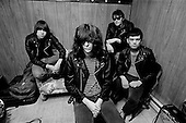 Denver, Colorado<br /> USA<br /> May 9, 1983<br /> <br /> Back stage with the Ramones - singer: Joey Ramone (center), lead guitar: Johnny Ramone (left), basist: Dee Dee Ramone (right) and drummer: Tommy Ramone (back right). <br /> <br /> The Ramones were an American rock band that formed in Forest Hills, Queens, New York in 1974, often cited as the first punk rock group. Despite achieving only limited commercial success, the band was a major influence on the punk rock movement both in the United States and the United Kingdom.<br /> <br /> All of the band members adopted pseudonyms ending with the surname &quot;Ramone&quot;, though none of them were actually related. They performed 2,263 concerts, touring virtually nonstop for 22 years. In 1996, after a tour with the Lollapalooza music festival, the band played a farewell show and disbanded<br /> <br /> By a little more than eight years after the breakup, the band's three founding members--lead singer Joey Ramone, guitarist Johnny Ramone, and bassist Dee Dee Ramone--had all died.
