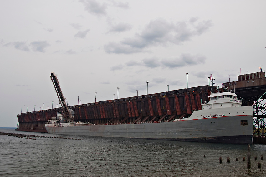The Great Lakes freighter Michipicoten loads iron ore at the ore dock in Marquette Michigan.