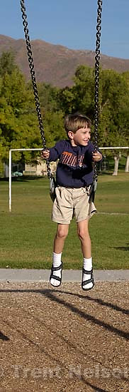 Noah Nelson on swing at Sugarhouse Park. 10/15/2001, 4:45:33 PM<br />