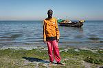 pêcheurs artisans lors du débarquement du poisson sur la plage de Ann à Dakar.