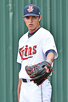 Elizabethton Twins starting pitcher Derek Rodriguez (12) warms up before a game against the Bristol Pirates on September 1, 2015 in Elizabethton, Tennessee. The Twins defeated the Pirates Gnats 6-1. (Tony Farlow/Four Seam Images)