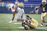 Annapolis, MD - September 8, 2018: Navy Midshipmen defensive end Josh Webb (92) tackles Memphis Tigers wide receiver Damonte Coxie (10) during the game between Memphis and Navy at  Navy-Marine Corps Memorial Stadium in Annapolis, MD.   (Photo by Elliott Brown/Media Images International)
