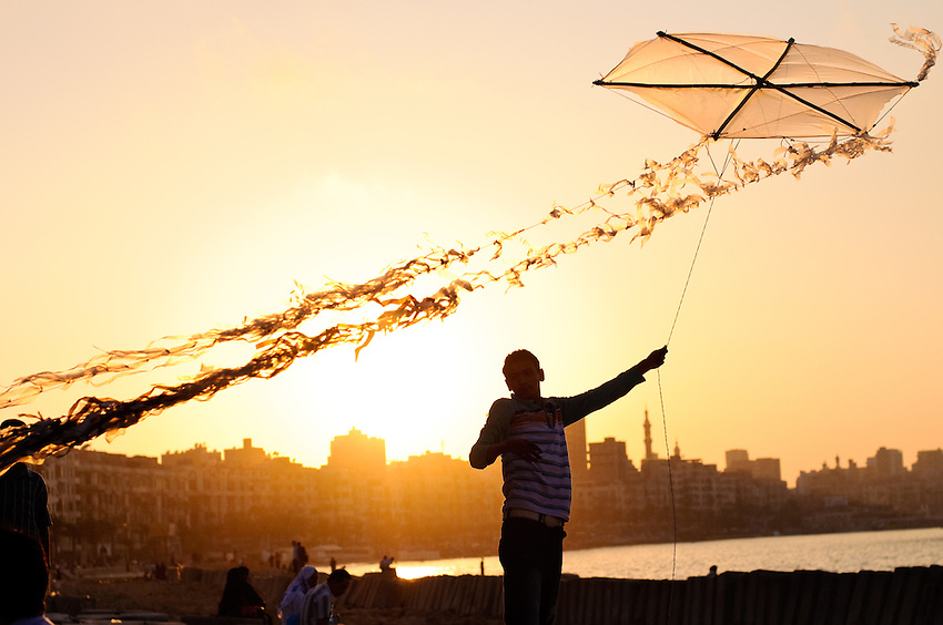 A kite flyer along the Corniche in Alexandria