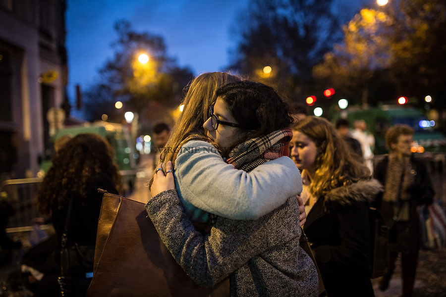 FRANCE, Paris: Women crying in front of the Bataclan as the police opened the acces after 3 days of investigation inside the place, November 17, 2015. People where displacing flowers, candles and words from the first gate to in front of the Bataclan where 89 people got killed by terrorists attacks. <br /> <br /> FRANCE, Paris: des jeunes femmes pleurent devant le Bataclan lorsque la police a ouvert les acces apres 3 jours d'enqu&ecirc;te &agrave; l'int&eacute;rieur du lieu, le 17 Novembre 2015. Les gens deplacaient fleurs, bougies et mots de la premi&egrave;re barriere vers l'avant du Bataclan, o&ugrave; 89 personnes ont ete tuees par des attaques terroristes.