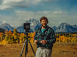 John and view camera in Grand Teton National Park, Wyoming. John offers autumn photo tours throughout Colorado and Wyoming.