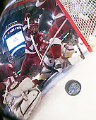 Kyle Richter (Harvard 33) and Brian McCafferty (Harvard 2) can't stop Orpik who watches as the puck heads to the back of the net to make it 5-3 BC. The Boston College Eagles defeated the Harvard University Crimson 6-5 in overtime on Monday, February 11, 2008, to win the 2008 Beanpot at the TD Banknorth Garden in Boston, Massachusetts.