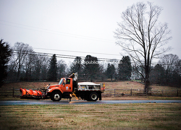 Middlebury, CT- 12 January 2016-011216CM05- A plow truck makes it's way along Tucker Hill Road in Middlebury on Tuesday.  Crews were out preparing for the inclement winter weather that was expected to hit the region on Tuesday into Wednesday.    Christopher Massa Republican-American