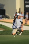 Lee Westwood's caddy Billy Foster lines up Lee's putt on the 18th green during the Final Day of the Dubai World Championship, Earth Course, Jumeirah Golf Estates, Dubai, 28th November 2010..(Picture Eoin Clarke/www.golffile.ie)