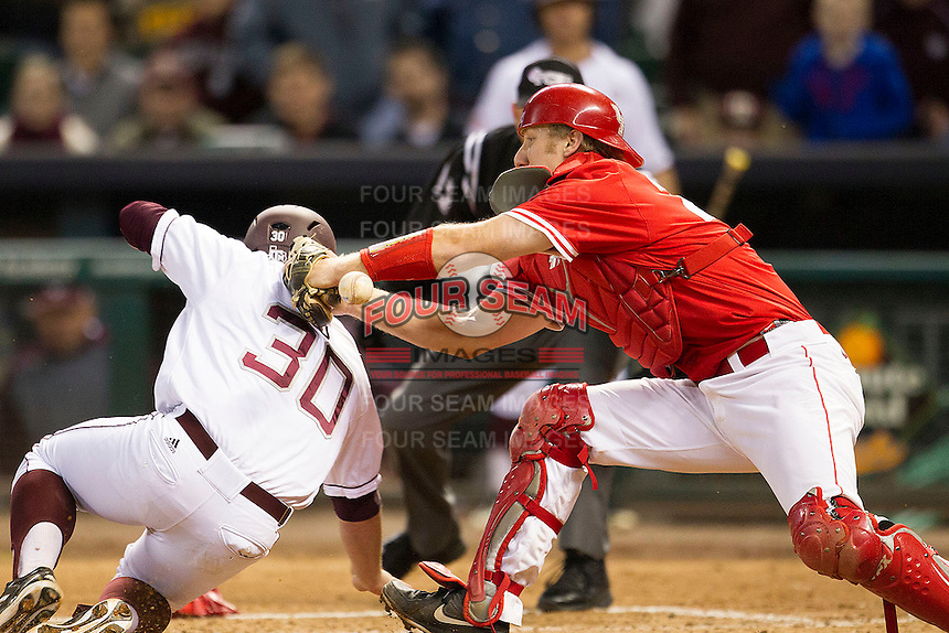 Houston Cougar catcher Caleb Barker #27 applies a rage without the ball on Texas A&M Aggie baserunner Mitchell Nau #3 in the NCAA baseball game on March 1st, 2013 at Minute Maid Park in Houston, Texas. Houston defeated Texas A&M 7-6. (Andrew Woolley/Four Seam Images).