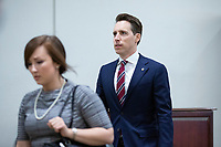 United States Senator Josh Hawley (Republican of Missouri) walks through the Senate Subway during a cloture vote on a Coronavirus Stimulus Package at the United States Capitol in Washington D.C., U.S., on Monday, March 23, 2020.  Credit: Stefani Reynolds / CNP/AdMedia