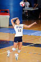 13 September 2008:  FIU libero Mariana Drumeva (10) serves in the first set of the FIU 3-0 (25-11, 25-19, 25-19) victory over Penn in the 2008 FIU Invitational tournament at Panther Arena in Miami, Florida.