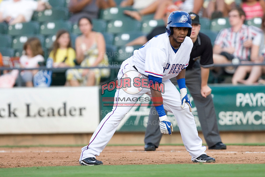 Round Rock Express outfielder Julio Borbon #20 leads off of first base in a game against the Memphis Redbirds at the Dell Diamond on July 7, 2011in Round Rock, Texas.  Round Rock defeated Memphis 6-4.  (Andrew Woolley / Four Seam Images)