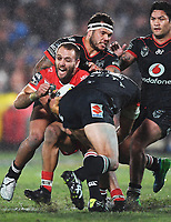 Jazz Tevaga and Simon Mannering tackle Jason Nightingale.<br /> NRL Premiership rugby league. Vodafone Warriors v St George Illawarra. Mt Smart Stadium, Auckland, New Zealand. Friday 20 April 2018. &copy; Copyright photo: Andrew Cornaga / www.Photosport.nz