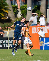 Los Angeles Galaxy defender Gregg Berhalter (16) and Houston Dynamo forward Brian Ching (25) go for the header. Houston Dynamo tied Los Angeles Galaxy 0-0 at Robertson Stadium in Houston, TX on October 18, 2009.