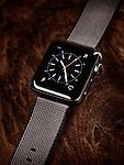 Apple Watch smartwatch on wooden desk background
