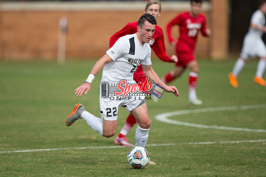 Jack Harrison (22) of the Wake Forest Demon Deacons brings the ball up the field during first half action against the Louisville Cardinals in the quarterfinal round of the 2015 ACC Men's Soccer Championship at Spry Soccer Stadium on November 8, 2015 in Winston-Salem, North Carolina.  The Demon Deacons defeated the Cardinals 2-1 in overtime..  (Brian Westerholt/Sports On Film)