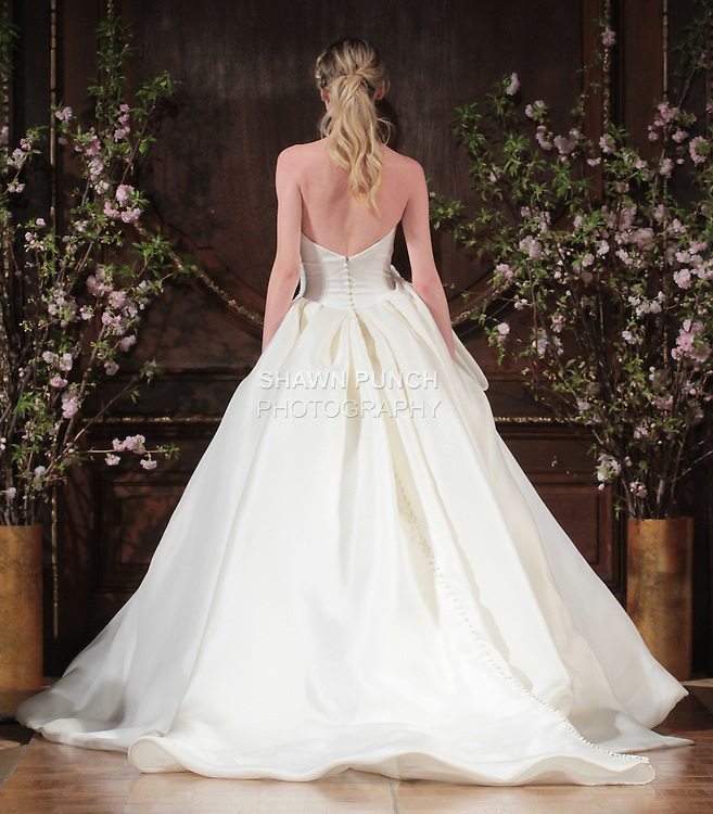 """Model walks runway in a """"Brett"""" bridal gown from the Isabelle Armstrong Spring Collection 2017, at Lotte New York Palace Hotel, during New York Bridal Fashion Week Spring Summer 2017 on April 16, 2017."""