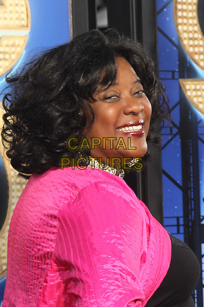 LORETTA DEVINE.The 20th Century Fox 'Glee 3D' Concert World Movie Premiere held at The Regency Village theatre in Westwood, California, USA,.August 6th 2011..headshot portrait side pink jacket necklace   .CAP/CEL.©CEL/Capital Pictures