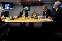 United States President Donald J. Trump, second from right, speaks during a teleconference with governors at the Federal Emergency Management Agency headquarters, Thursday, March 19, 2020, in Washington, DC. US Vice President Mike Pence is at right and Department of Health and Human Services Secretary Alex Azar, is third from right.<br /> Credit: Evan Vucci / Pool via CNP/AdMedia