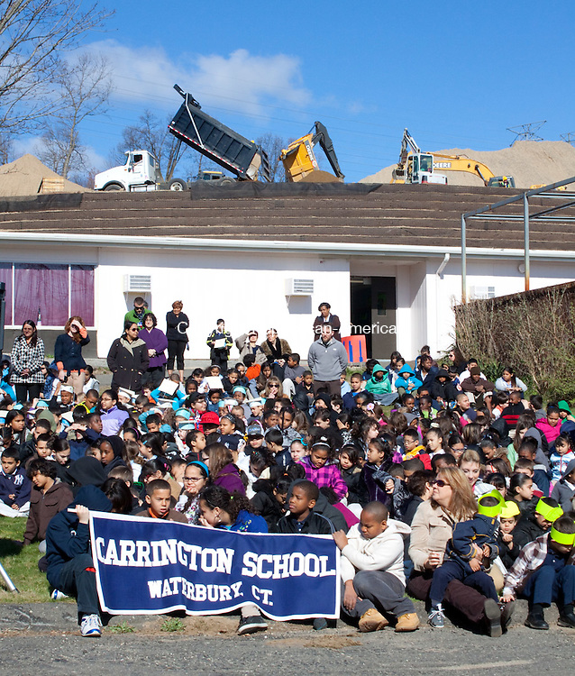 WATERBURY APRIL CT- 05 APRIL 2011-040512DA02-  Students of Carrington Elementary School  in Waterbury gather outside their school on Thursday during the Waterbury Board of Education breaking ground ceremony as crews work above on a construction site that will be a new pre-kindergarten through eighth grade school..Darlene Douty Republican American