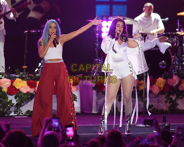MIAMI BEACH , FL - JUNE 10: Halsey (Ashley Nicolette Frangipane) and Lauren Jauregui perform during the iHeart Summer 17 concert at the Fontainebleau on June 10, 2017 in Miami Beach, Florida. <br /> CAP/MPI04<br /> &copy;MPI04/Capital Pictures