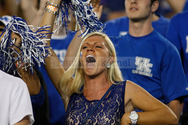 A UK student cheers during the first half of the UK vs. Kent State football game at Commonwealth Stadium in Lexington, Ky., on Saturday, September 8, 2012. Photo by Tessa Lighty | Staff