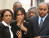 """Landover, MD - October 26, 2002 -- The family of Conrad Everton Johnson, the bus driver killed by the """"Beltway Sniper"""" , arrives for his funeral at the Glendale Baptist Church.  His wife, Denise E. Johnson, walks into the church accompanied by other family members.<br /> Credit: Ron Sachs / CNP<br /> (RESTRICTION: NO New York or New Jersey Newspapers or newspapers within a 75 mile radius of New York City)"""