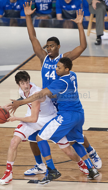 Kentucky Wildcats center Dakari Johnson (44) and forward James Young (1) block Wisconsin Badgers forward Frank Kaminsky (44) while he tries to go towards the basket during the NCAA Final Four vs. Wisconsin at the AT&T in Arlington, Tx., on Saturday, April 5, 2014. Photo by Eleanor Hasken | Staff