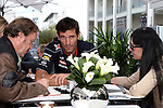 Mark Webber (2) driver of the Red Bull Racing Renault does an interview before the Formula 1 United States Grand Prix practice session at the Circuit of the Americas race track in Austin,Texas.