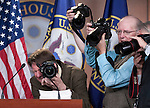 "UNITED STATES - APRIL 5: News photographers take photos of House Budget Chairman Paul Ryan's budget proposal ""The Path to Prosperity"" on the podium before the start of the news conference on the FY2012 budget resolution on Tuesday, April 5, 2011. (Photo By Bill Clark/Roll Call)"