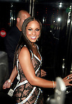 Alicia Keys.Attending the 2005 Songwriters Hall Of Fame at the.Marriott Marquis Hotel in New York City..( entering a revolving door ).