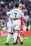Cristiano Ronaldo of Real Madrid celebrates with teammate Lucas Vazquez after scoring a penalty during the La Liga 2017-18 match between Real Madrid and Sevilla FC at Santiago Bernabeu Stadium on 09 December 2017 in Madrid, Spain. Photo by Diego Souto / Power Sport Images