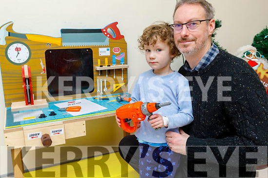 Little Jack Barry showing the new donated toys to his dad Sean that have being given to the Cashel Ward by the Raheen Play Group from Killarney on Saturday morning.