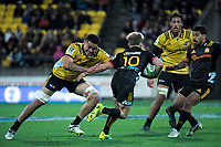 Vaea Fifita tries to stop Damien McKenzie during the Super Rugby quarterfinal match between the Hurricanes and Chiefs at Westpac Stadium in Wellington, New Zealand on Friday, 20 July 2018. Photo: Dave Lintott / lintottphoto.co.nz