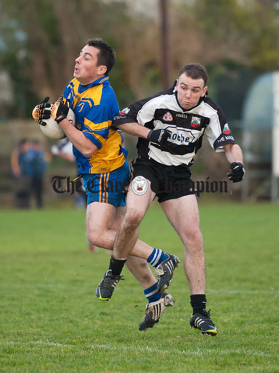 Enda Hehir of Michael Cusack's in action against Eamon Callinan of Clarecastle during their Junior A football final at Corofin. Photograph by John Kelly.