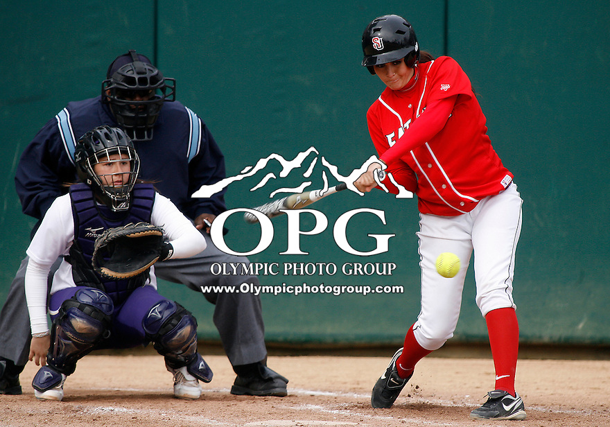 14 March 2010:  Seattle University's #39 Jessica Amandor connects for a base hit against Washington. Washington defeated Seattle University 8-3 at Husky Softball Stadium in Seattle, WA.