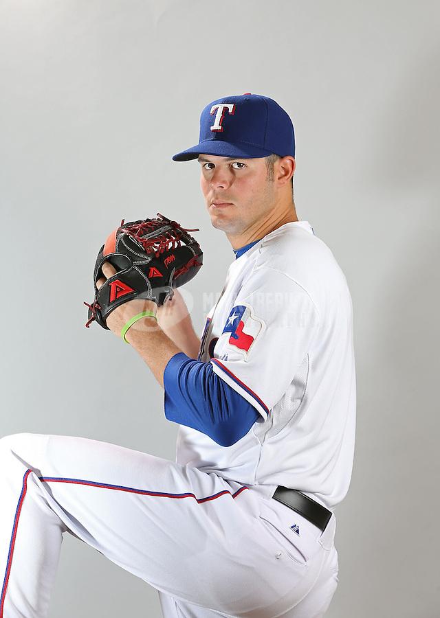 Feb. 20, 2013; Surprise, AZ, USA: Texas Rangers pitcher Jake Brigham poses for a portrait during photo day at Surprise Stadium. Mandatory Credit: Mark J. Rebilas-