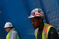 New York, USA. 1st May 2014.  Workers relax at lunch during the annual 1 May day rally in New York.  Eduardo MunozAlvarez/VIEWpress
