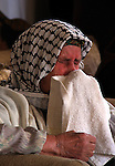 A Palestinian woman mourns over the body of young Palestinian Ahmad Daragma, 21, during his funeral, in the West Bank town of Tubas, near Jenin City, on January 2, 2010. Israeli soldiers shot dead Daragma at the Hamra checkpoint east of Nablus in the northern West Bank, the Israeli military and medics said. Photo by Wagdi Eshtayah