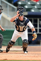 NW Arkansas Naturals catcher Micah Gibbs (27) keeps an eye on the runner while retrieving a pitch in the dirt during a game against the Corpus Christi Hooks on May 26, 2014 at Arvest Ballpark in Springdale, Arkansas.  NW Arkansas defeated Corpus Christi 5-3.  (Mike Janes/Four Seam Images)