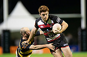 Andrew Kellaway makes a break past Jayson Potroz. Mitre 10 Cup rugby game between Counties Manukau Steelers and Taranaki Bulls, played at Navigation Homes Stadium, Pukekohe on Saturday August 10th 2019. Taranaki won the game 34 - 29 after leading 29 - 19 at halftime.<br /> Photo by Richard Spranger.