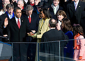 Washington, DC - January 20, 2009 -- United States President Barack Obama takes the oath of office from United States Chief Justice John Roberts as he is sworn in as the 44th President of the United States in Washington, DC, USA, 20 January 2009. Obama defeated Republican candidate John McCain on Election Day 04 November 2008 to become the next U.S. President.  Obama's wife, Michelle, holds the Lincoln bible as daughters Malia and Sasha look on..Credit: Matthew Barrick - CNP
