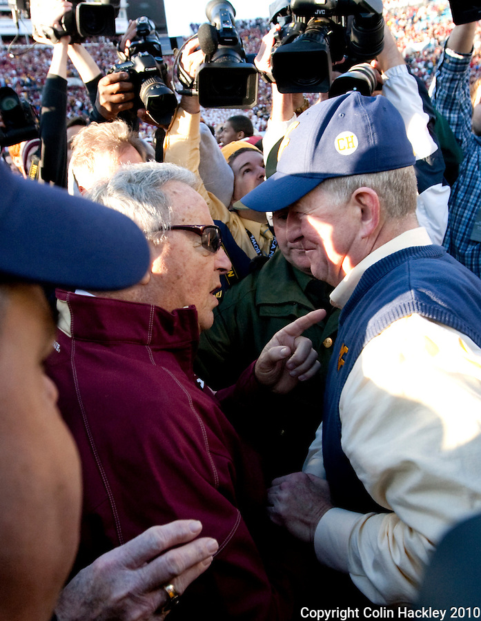 JACKSONVILLE, FL 1/1/10-FSU-WV FB CH76-Florida State Head Coach Bobby Bowden meets West Virginia Head Coach Bill Stewart at midfield at the close of Bowden's final game in the Gator Bowl Friday in Jacksonville, Fla. The Seminoles beat the Mountaineers 33-21..COLIN HACKLEY PHOTO