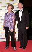 "United States Representative James L. Oberstar (Republican of Minnesota) arrives with his wife at the Harry S. Truman Building (Department of State) in Washington, D.C. on December 4, 2004 for a dinner hosted by United States Secretary of State Colin Powell.  At the dinner six performing arts legends will receive the Kennedy Center Honors of 2004.  This is the 27th year that the honors have been bestowed on ""extraordinary individuals whose unique and abundant artistry has contributed significantly to the cultural life of our nation and the world"" said John F. Kennedy Center for the Performing Arts Chairman Stephen A. Schwarzman.  The award recipients are: actor, director, producer, and writer Warren Beatty; husband-and-wife actors, writers and producers Ossie Davis and Ruby Dee; singer and composer Elton John; soprano Joan Sutherland; and composer and conductor John Williams.<br /> Credit: Ron Sachs / CNP"
