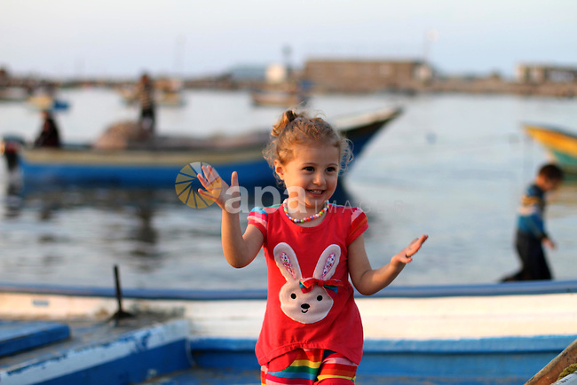 A Palestinian girl plays at the seaport during the sunset, in Gaza City on April 25, 2014. Israel said it was halting negotiations with the Palestinians following their unity deal with the Hamas rulers of Gaza, as faltering US-backed peace talks approached their deadline. Photo by Mohammed Asad