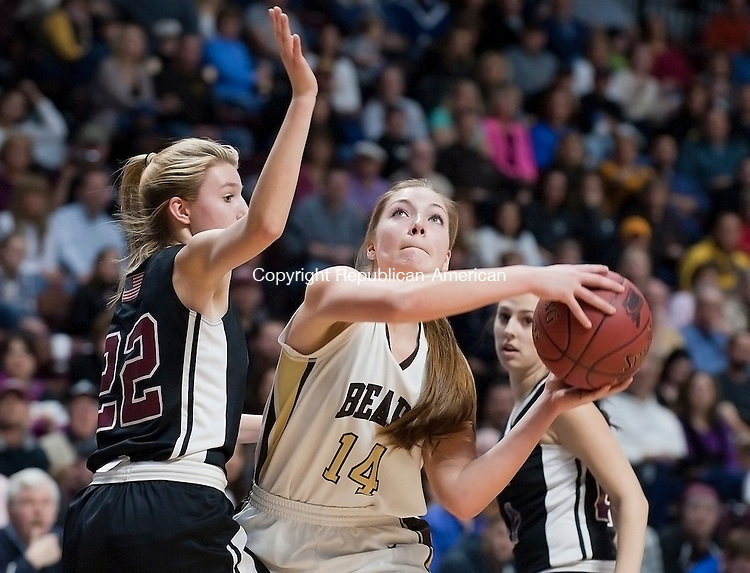 UNCASVILLE, CT--- -031916JS08- Thomaston's Morgan Sanson (14) puts up a shot in front of Canton's Emily Briggs (22) during their Class S state championship game Saturday at Mohegan Sun Arena. <br /> Jim Shannon Republican-American
